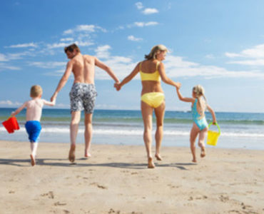 A la playa con la familia